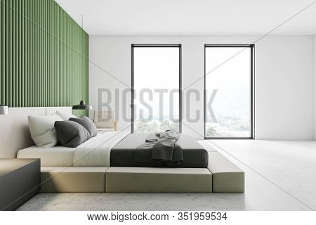Side View Of Stylish Minimalistic Master Bedroom With Green Walls, Concrete Floor, Comfortable King