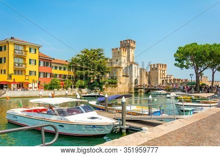 August, 06, 2019- Sirmione, Italy: View Of The Medieval Castle Scaliger On Lake Garda