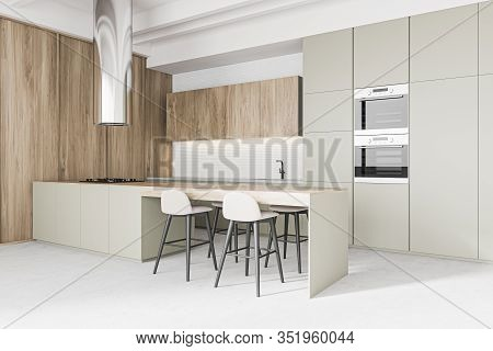 Corner Of Modern Kitchen With Wooden And White Walls, Concrete Floor, Grey Countertops And Long Bar
