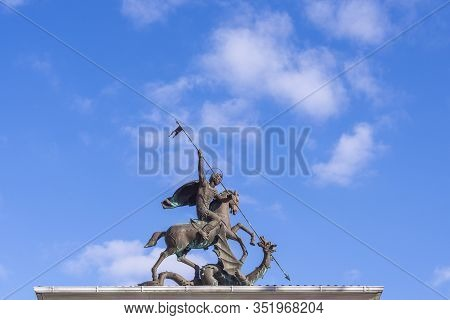 Krasnodar, Russia - February 16, 2020: Saint Georges The Victorious Statue On Top Of A Memorial Arch