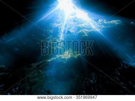 Underwater Photo Of Magical Sunlight Inside A Cave. From A Scuba Dive At Ko Haa In Thailand.