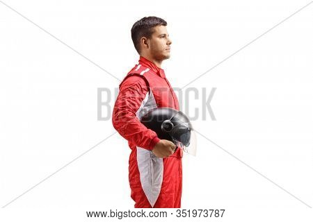 Racer in a red jumpsuit standing and holding a halmet isolated on white background