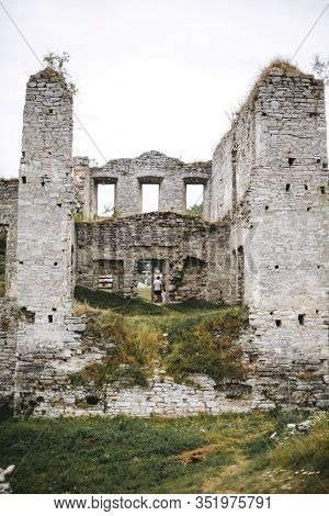 Old Ruins Of Skala Podilskyi Castle, Ukraine. Destroyed Ruined Stone Walls Of Medieval Castle And Gr
