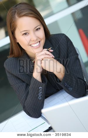 Pretty Business Woman At Office