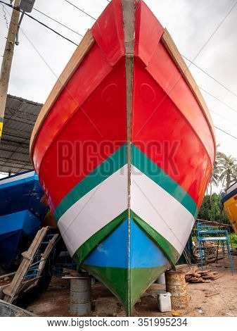 Closeup Image Of Beautiful Colorful Painted Fishing Boat Nose In Docks At Port