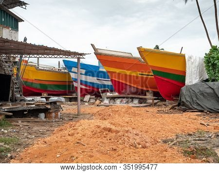 Photo Of Colorful Fishing Boats Being Painted In The Docks At Small Seaside Village In Sri Lanka