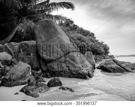 Black And White Image Of Big Rocks On The Beach At Tropical Island Lagoon