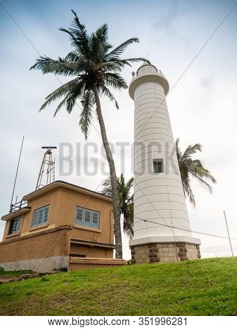 Beautiful Photo Of Old Lighthouse And High Palm Tree On The Island