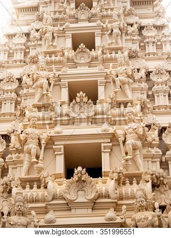 Closeup Photo Of Beautiful Carved Stone Statues Of Gods On The Roof Of Hindu Temple