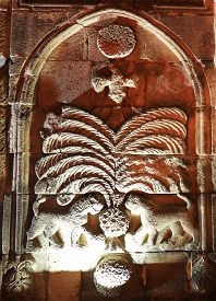 Medieval Stone Carving Art On Exterior Wall Of Yakutiye Madrasah In Erzurum Turkey. Two Lions, Tree