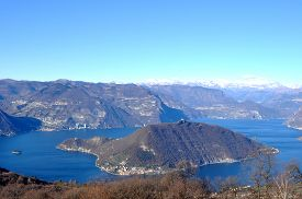 Panoramic Image Of Lake Iseo And The Town Of Peschiaera In Montisola In The Province Of Brescia - Lo