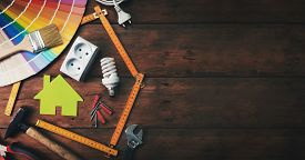 Home Improvement And Repair Concept - Construction Tools And Objects On Wooden Background. Top View