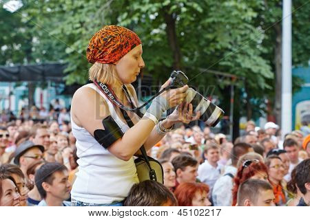 MOSCOW - JUN 23: Music fans at concert of Chaif rock-band during VII traditional festival of live sound Music of Summer in Hermitage Garden, Jun 23, 2012, Moscow, Russia.