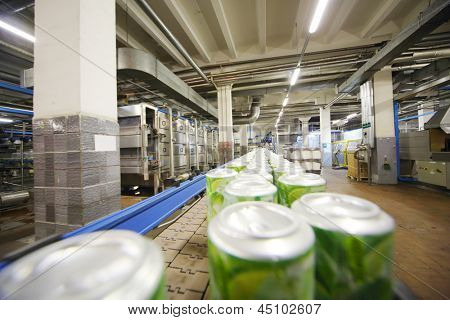 MOSCOW - MAY 16: Cans with drink mojito on conveyor in Ochakovo factory, on May 16, 2012 in Moscow, Russia. Ochakovo - is one of most modern plants, not only in Russia but also in Europe.