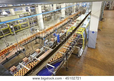 MOSCOW - MAY 16: Top view of conveyor with beer in Ochakovo factory, on May 16, 2012 in Moscow, Russia. Ochakovo has breweries in several Russian cities - Moscow, Krasnodar, Tyumen, Penza.