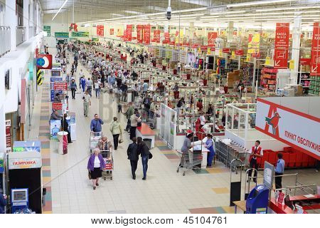 SAMARA - MAY 5: People make purchases in Auchan superstore, on May 5, 2012 in Samara, Russia. French distribution network Auchan unites more than 1300 shops.