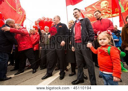 MOSCOW - MAY 1: Gennady Zyuganov (center) (is a Russian politician, First Secretary of the Communist Party of the Russian Federation) during procession of May Day on May 1, 2013 in Moscow, Russia.