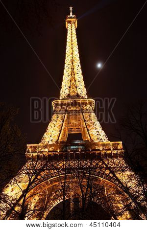 PARIS, FRANCE - April 17: Evening lighting of the Eiffel tower on April 17, 2013 in Paris, France. The Eiffel tower is the most visited monument of France.