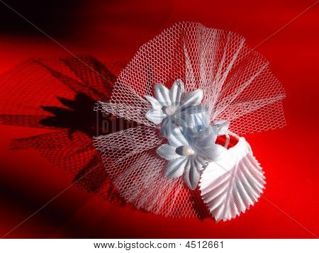 Handmade wedding white flower decoration on red background poster