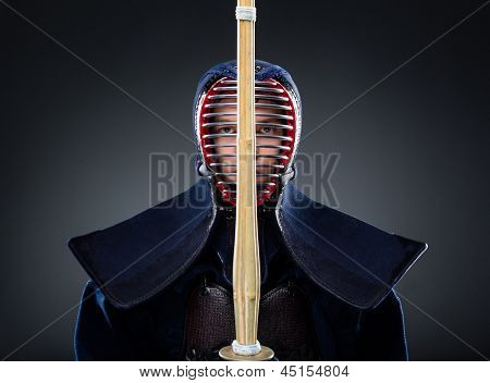 Kendoka keeps the shinai in front of the face. Japanese martial art of sword fighting