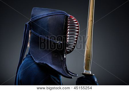 Profile of kendoka with shinai. Japanese martial art of sword fighting