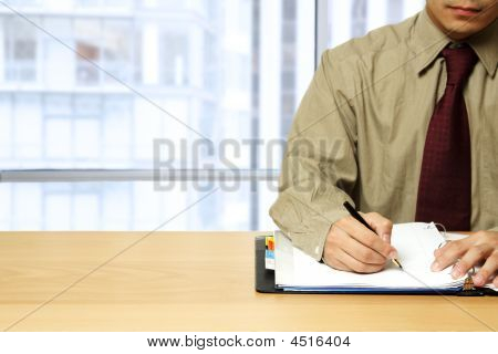 Working Businessman At Office