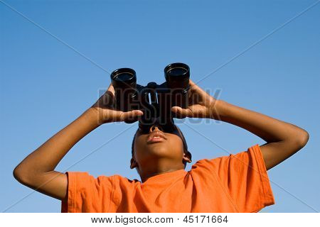 boy sees something through binoculars