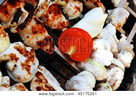 grilled and raw chicken shish kebab cooked on barbecue appliance poster