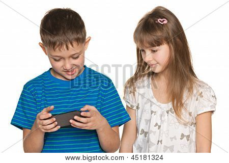 Two Kids Playing With Smartphone