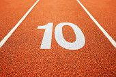 Number ten on athletics all weather running track poster