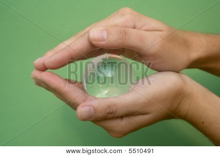 Hands With Glass Globe