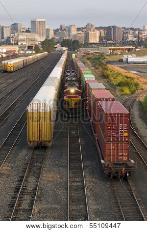 Railroad Switching Yards Rails Cars Boxcars Engine Locomotive Downtown
