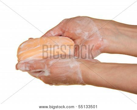Woman washes hands about the soap