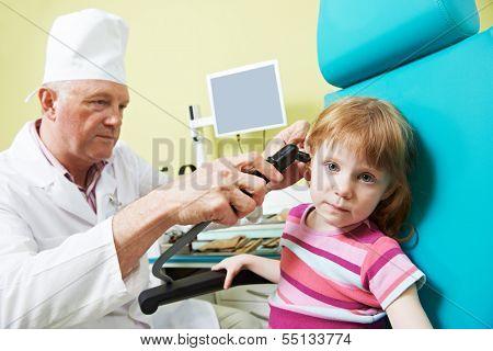 Medical otolaryngologist ear nose throat doctor examining little girl
