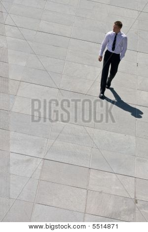 Corporate Man Walking On Pavement
