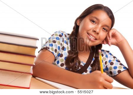 Pretty Smiling Hispanic Girl Studying
