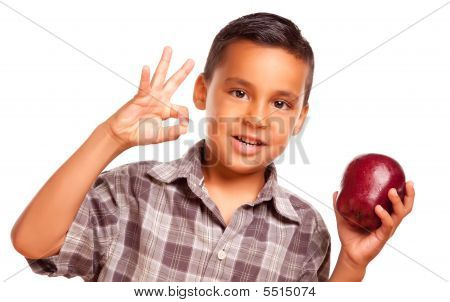 Adorable Hispanic Boy With Apple And Okay Hand Sign