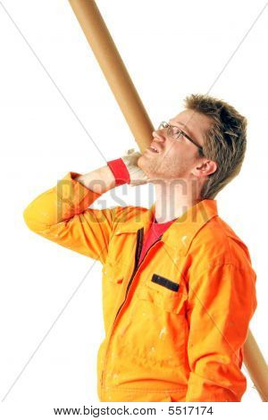 Worker With Tool Looking Upstairs