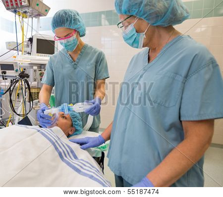 Nurses preparing patient before operation in hospital poster