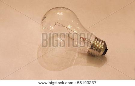 Incandescent Light Bulb on White Paper