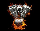 Chromed motorcycle engine on fire on a black background poster