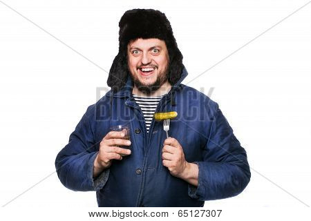 Happy, peaceful, crazy russian man with vodka and appetizer