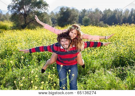 Young Couple Frolicking In The Countryside