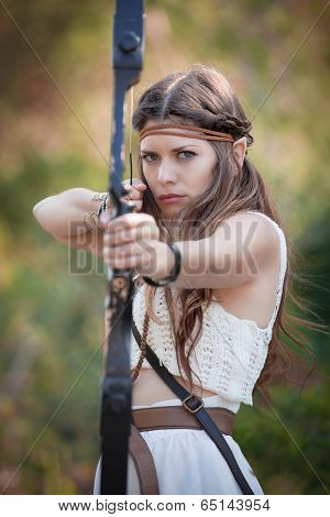 elf mythical hunter  girl shooting bow and arrow