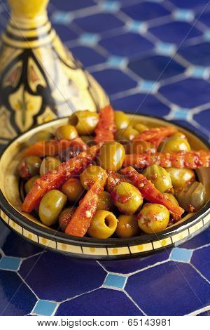 Moroccan hot harissa olives in a tagine