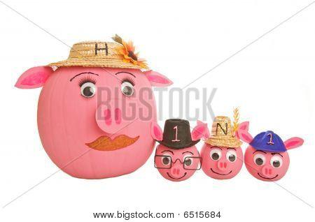 Family of swine pumpkins depicting the H1N1 swine flu virus.