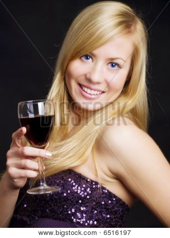 Smiling Beautiful Woman Holding Wine And Celebrating New Year
