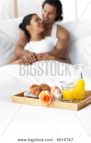 Smiling Lovers Having Breakfast On The Bed
