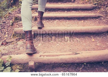 Close Up On  Woman's Legs Walking In Nature