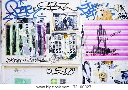 LONDON, UK - APRIL 18, 2014: Graffiti, posters and stickers on Brick Lane, Banglatown,  Spitalfields / Whitechapel.
